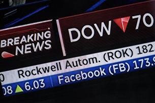 Котировки акций компании Facebook, показанные на информационной панели биржи NASDAQ