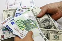 Курс американской валюты к евро снижается на данных из США и на ожиданиях запроса финпомощи Испанией